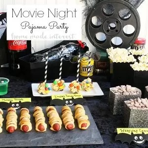 Pajama Party Movie Night - Put on your favorite PJs and grab some snacks, this Pajama party Movie night party is the perfect way to entertain the kids when the weather gets cold and they can't go out and play. Sticky, salty and sweet S'Mores Popcorn balls are made with M&M's and movie theater microwave popcorn for the perfect movie night treat.