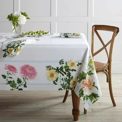 Shabby chic Easter table decorations and settings with soft color and adorable bunnies. Moss table runner on the floral tablecloth looks amazing.