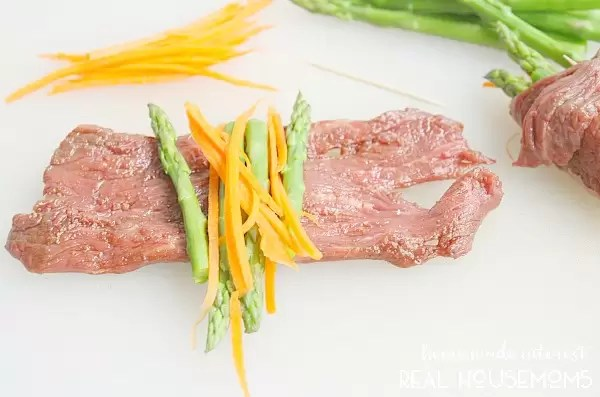 These Balsamic Steak Roll Ups are made with thin slices of flank steak, marinated in balsamic vinegar and rolled up around fresh vegetables. It is an easy dinner recipe that you can cook on the grill or on the stove. This is a great party recipe and it is perfect for a romantic Valentine's Day dinner!