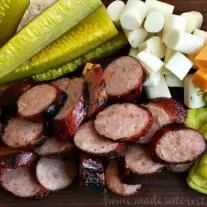 If you love Memphis barbeque then you are going to love this Memphis BBQ Sausage Platter. It is a traditional BBQ appetizer with BBQ grilled sausage, cheese, peppers and pickles. This is a great summer BBQ recipe that is perfect to take to a party or a cookout.