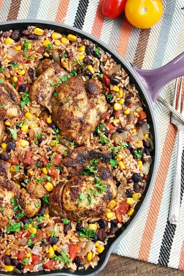 This easy one pot Mexican chicken and rice recipe is filled with tex-mex flavor and cooked with rice, corn, and black beans to make a complete meal in one pot! This chicken recipe is perfect for an easy family dinner.
