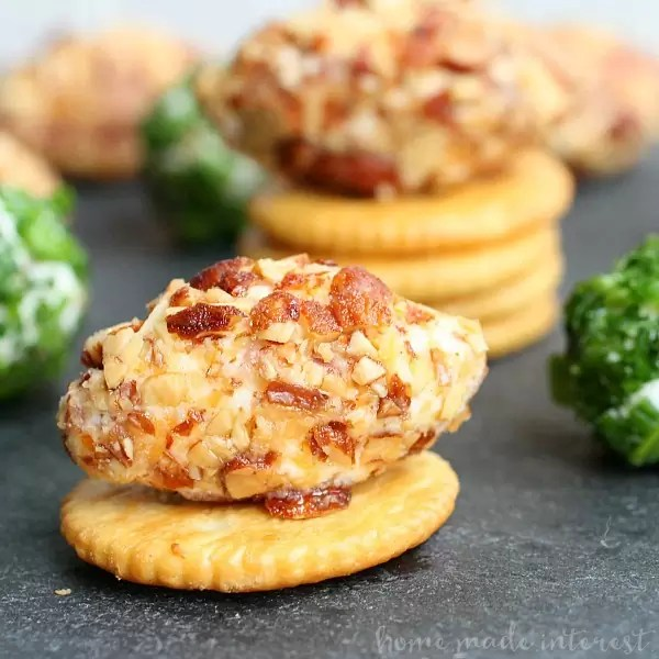 These simple game day bacon cheese balls are an easy game day appetizer that everyone will love! Make these bacon cheese balls for your next tailgating, game day, or superbowl party and watch them disappear. This is an easy game day recipe that going perfect on a cracker.