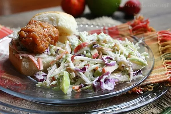 This fall coleslaw recipe is made with crisp fall apples for a sweet fall flavor that is perfect for tailgating, game day parties, and as a Thanksgiving side dish recipe. I like to add some to my honey BBQ sliders to add a little crunch or I just serve it as a fall side dish recipe to eat with hot dogs and burgers.