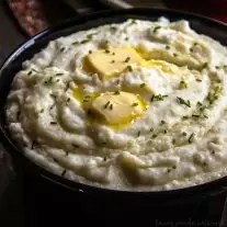 If you're looking for the best mashed potatoes recipe then you've come to the right place. This mashed potatoes recipe is a favorite at all of my holiday dinners, Thanksgiving, Christmas, and Easter especially! These mashed potatoes are rich and creamy and made with a secret ingredient that is going to make your next dinner extra special! If you're looking for an easy side dish recipe that can be made ahead of time you have to try this easy mashed potatoes recipe!