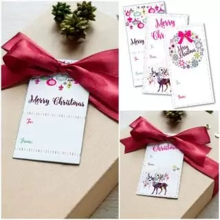 It is so easy to make your own Christmas or holiday gift tags! This year I designed my own Christmas gift tags and in the spirit of giving I'm sharing them so download your free printable christmas gift tags with bright colors and fun deer, wreath, and ornament designs!