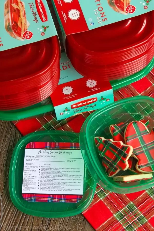 We are Mad for plaid this year and we turned that into a theme for our Christmas cookie exchange. Plaid table decorations, free cookie exchange recipe cards, and plaid sugar cookies. Check out how to host a cookie exchange and download our free printable recipe cards for your next party.