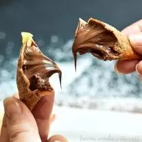 These decadent Nutella Wontons are crisp wontons filled with creamy, rich Nutella hazelnut spread. It's an easy Nutella dessert recipe everyone will love!