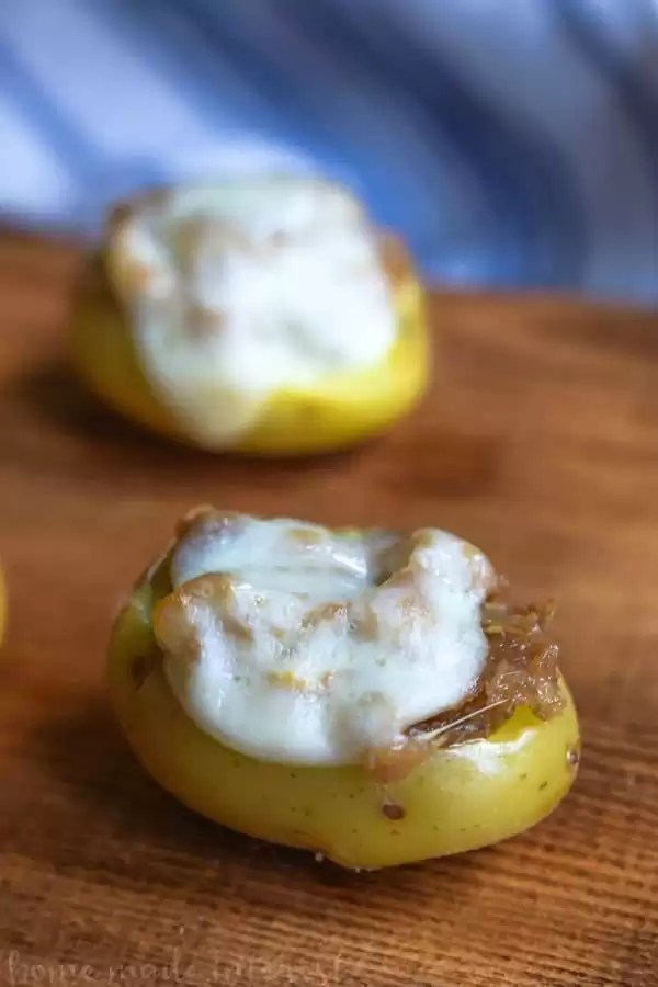 We made these Philly Cheesesteak Potato Bites two ways, original Philly cheesesteak and provolone Philly cheesesteak. These potato bites are an easy game day recipe that would be perfect for a Super Bowl party. They are like a potato skin recipe in miniature. Make this easy potato appetizer for your next party.