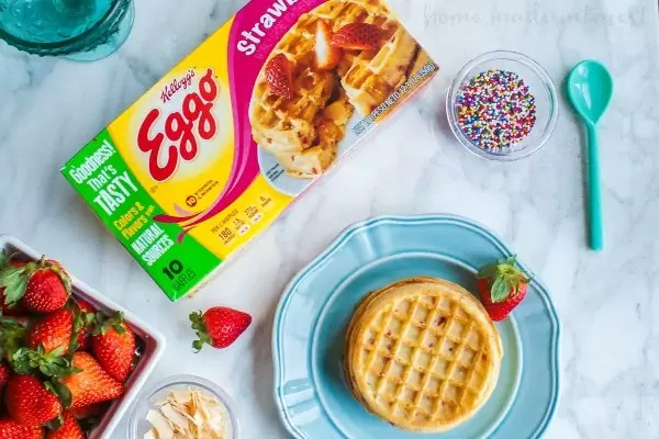Waffle Sundae | Make this easy Waffle Sundae recipe for a fun family night or just because you want the best sundae ever! Tasty waffles piled high with ice cream and topped with another waffle before covering it with your favorite ice cream toppings. Kids and adults will love this easy dessert recipe! Who wouldn't want ice cream and waffles?!