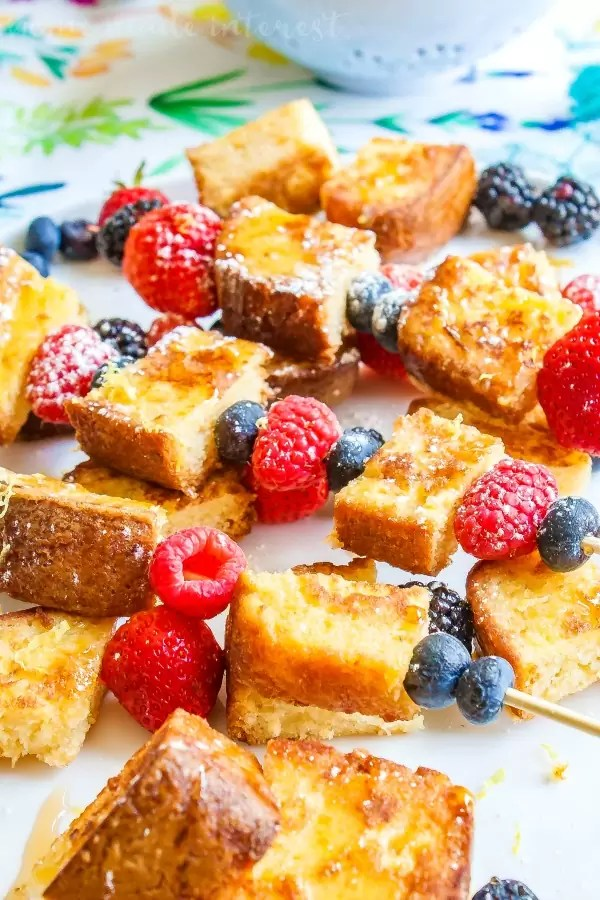 Lemon pound cake french toast with fresh raspberries and blueberries drizzled with syrup