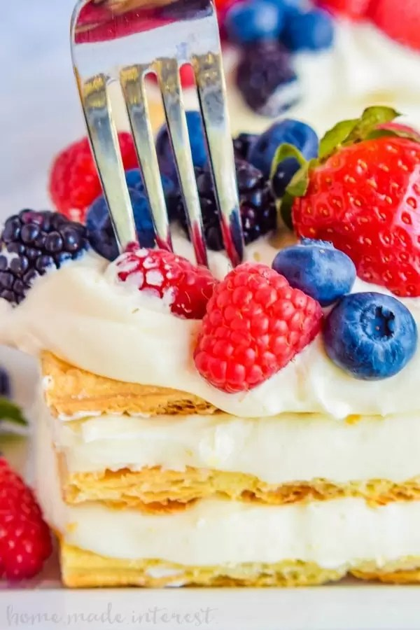 Lemon Berry Napoleons | Lemon desserts are perfect spring and summer dessert recipes! This lemon berry napoleon is layers of lemon mousse and flaky puff pastry stacked together and topped with beautiful fresh fruit. If you have been looking for an easy Napoleon recipe or an easy lemon dessert recipe this is it!