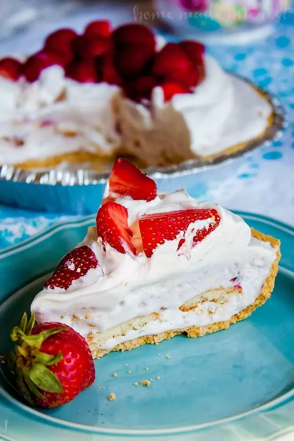 Strawberries and Ice Cream Pie | This easy ice cream pie makes a great spring or summer dessert recipe. Fresh strawberries, ice cream, and whipped topping all frozen into a graham cracker crust. This is a quick and easy pie recipe that takes less than 10 minutes to put together! If you're looking for an easy pie recipe for Easter or Mother's day make sure you give this strawberry ice cream pie a try!
