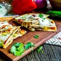 BBQ Pork Quesadillas | This easy quesadilla recipe is oozing cheese and filled with BBQ pork! This is a quick and easy dinner recipe for busy weeknights and a great lunch idea for kids when they are home all summer. These BBQ Pork Quesadillas are an awesome spin on my favorite Tex-Mex recipe!
