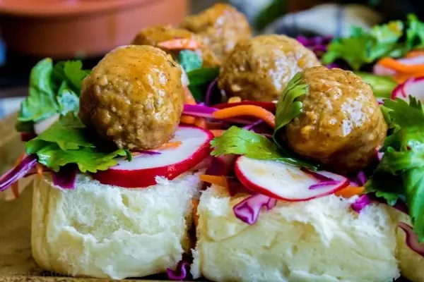Banh Mi Sliders open-faced with Korean BBQ meatballs on top of pickled vegetables