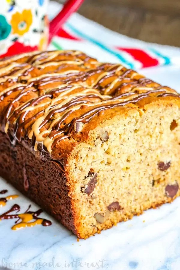 Peanut Butter Chocolate Chip Banana Bread   This easy banana bread recipe is a great way to use up those overripe bananas. Peanut Butter Chocolate Chip Banana Bread uses overripe bananas, peanut butter, and chocolate chips to make a moist banana bread. This easy quick bread recipe make a great snack recipe or dessert recipe!
