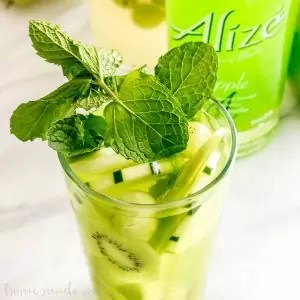 Green Goddess Hard Lemonade   This adult lemonade recipe is an easy summer cocktail recipe that everyone will love. Green Goddess Hard Lemonade mixes fresh lemonade with fruits and vegetables for a summer drink recipe you won't forget.