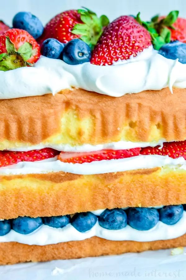 No Bake Red White and Blue Cake   This easy no bake red white and blue cake is a 4th of July dessert recipe that you don't want to miss. This no bake cake recipe is filled with whipped cream and fresh summer berries for a summer dessert recipe that everyone will love. Make this as a Memorial Day dessert recipe or Labor Day dessert recipe too.