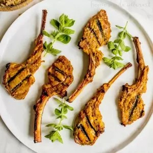 Tandoori Grilled Lamb Chops   This easy lamb chop recipe is a perfect summer grilling recipe. Tandoori-style lamb chops marinated in a tandoori yogurt and spice marinade then grilled on a Big Green Egg. We should you how to use a Big Green Egg to grill lamb chops with lots of flavor. If you love a good Indian food recipe these Indian-inspired grilled lamb chops are for you.