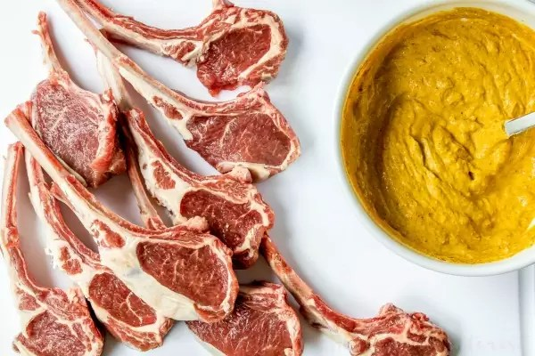 Tandoori Grilled Lamb Chops | This easy lamb chop recipe is a perfect summer grilling recipe. Tandoori-style lamb chops marinated in a tandoori yogurt and spice marinade then grilled on a Big Green Egg. We should you how to use a Big Green Egg to grill lamb chops with lots of flavor. If you love a good Indian food recipe these Indian-inspired grilled lamb chops are for you.