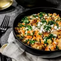 sausage and kale with riced veggies topped with a goat cheese crumble