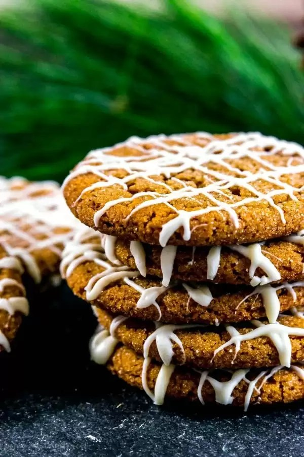 stacked gingersnap cookies with white chocolate drizzle