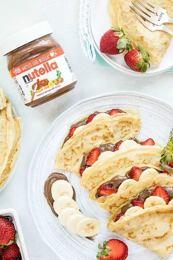 crepes filled nutella, strawberries and bananas
