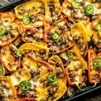 low carb nachos filled with carne asada, cheese, and jalapenos,.