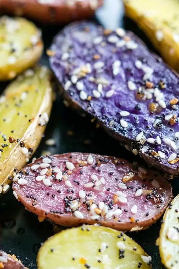 A close-up showing Everything Bagel seasoning on Roasted Fingerling Potatoes