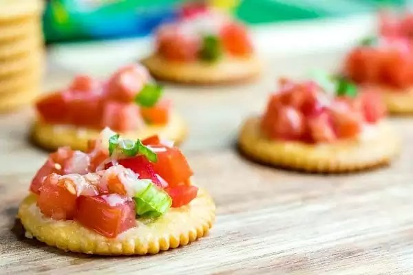 RITZ Bruschetta Toppers on a cutting board