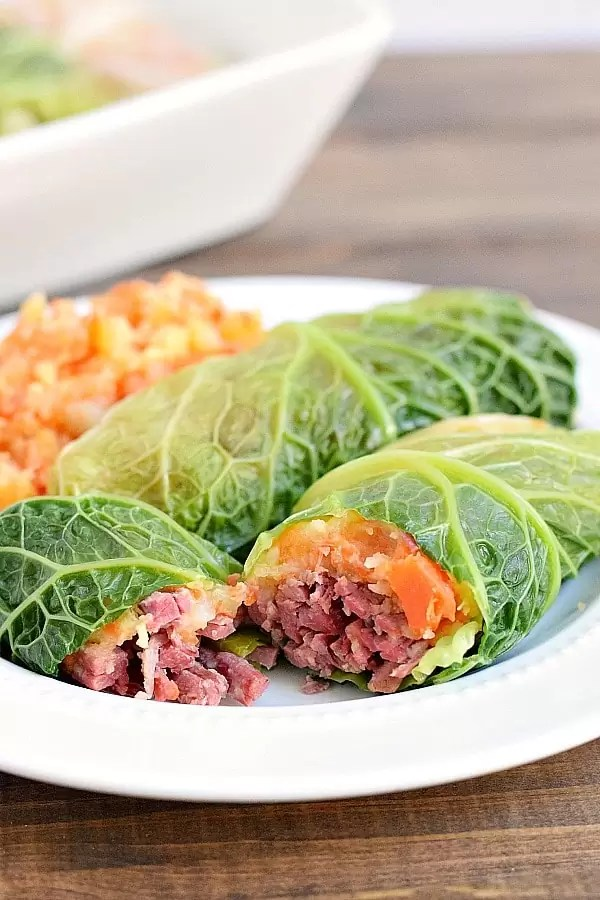 Two corned beef cabbage rolls on a plate