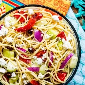 Greek Spaghetti Salad topped with feta