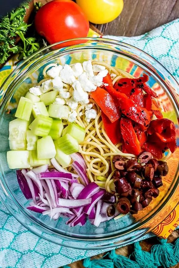 Greek Spaghetti Salad ingredients in a bowl