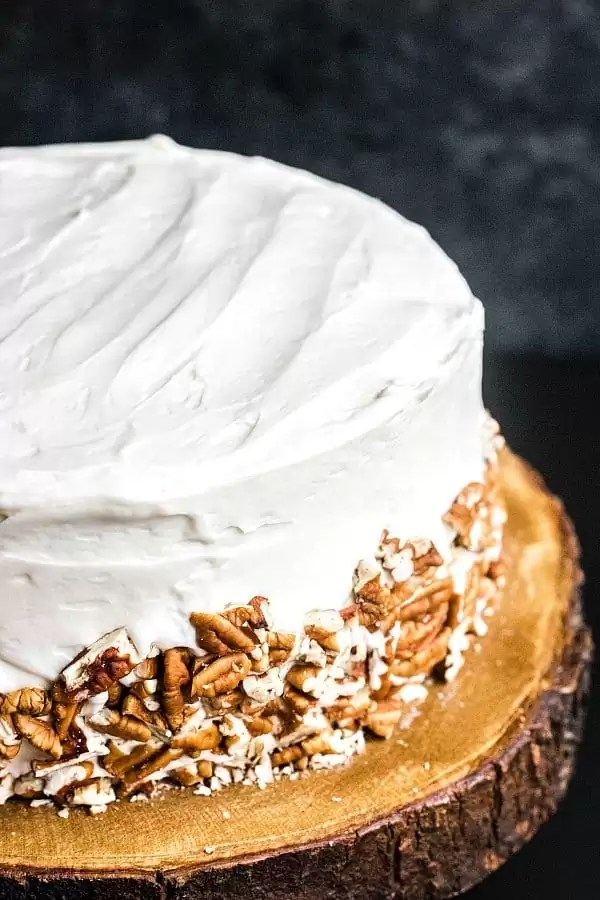 top of a frosted Hummingbird Cake