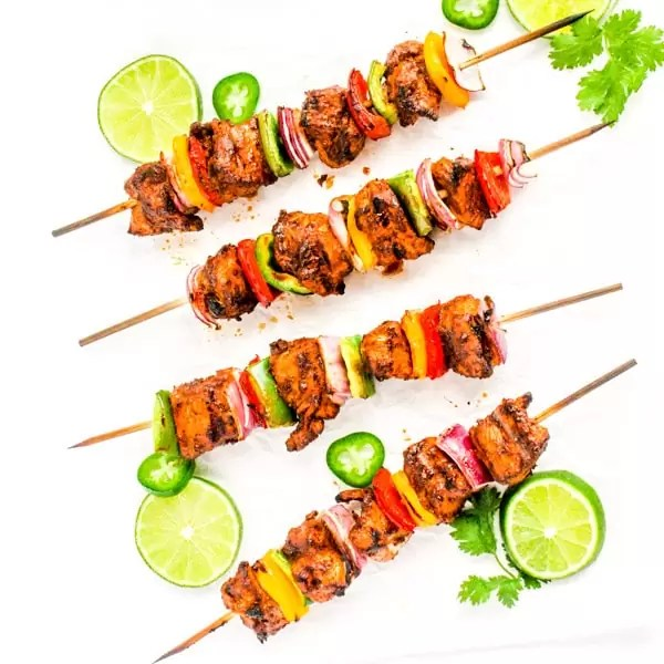 grilled chicken fajita skewers with lime slices