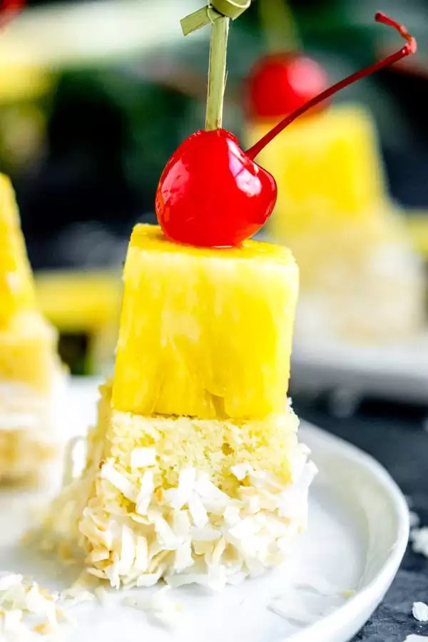 Pina Colada Cake Bite topped with a cherry