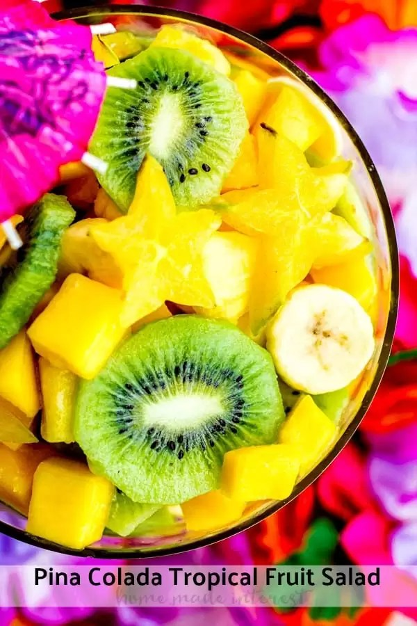 Pina Colada Tropical Fruit Salad is a mix of tropical fruits such as pineapple, kiwi, bananas, mango, and start fruit, tossed in a sweet and tangy coconut lime dressing. It is an easy fruit salad that is the perfect side for a potluck! #fruits #coconut #picnic #sidedish #tropical #homemadeinterest