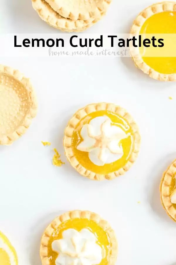 These easy Lemon Curd Tartlets are flaky, mini pastry tart shells filled with homemade lemon curd and topped with meringue that is lightly toasted. These lemon tarts are a delicious bite-sized dessert that is one of my favorite dessert recipes! These easy mini pies are a sweet treat everyone will love! #tart #baking #lemoncurd #lemon #meringue #dessert #dessertrecipes #homemadeinterest