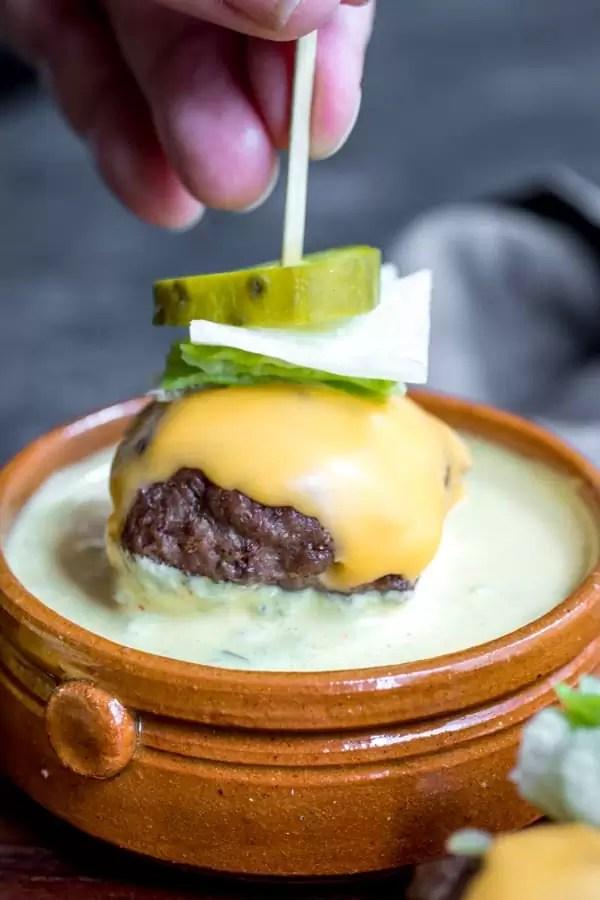 Low Carb Big Mac Bites dipping in sauce