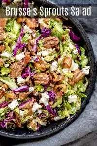 This easy Brussels Sprout Salad is filled with shaved or shredded Brussels sprouts, candied pecans, goat cheese, and bacon, tossed in a balsamic dressing. It is a raw Brussels sprout salad that is served cold. It is a delicious winter salad recipe that makes a delicious Thanksgiving side dish or Christmas side dish. #salad #brusselssprouts #thanksgiving #sidedish #christmas #pecan #homemadeinterest
