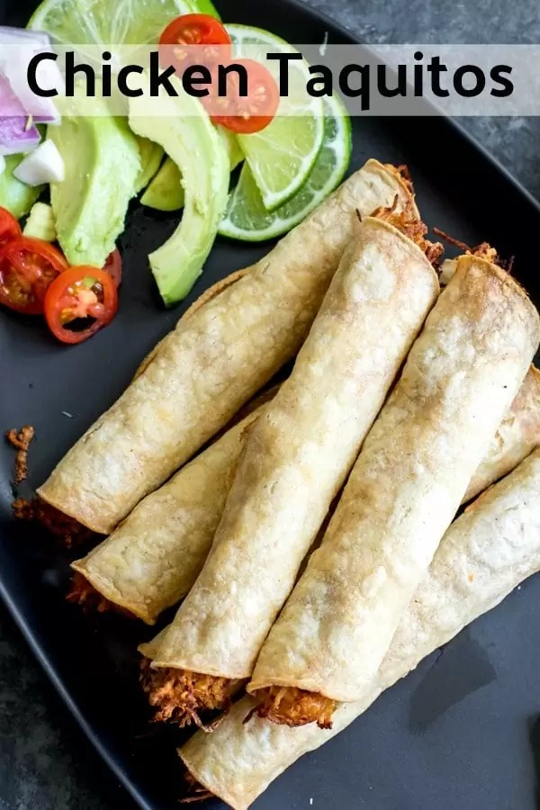 These easy, cheesy Chicken Taquitos are baked, not fried, and the corn tortillas are stuffed full of shredded chicken seasoning with homemade taco seasoning, and lots of cheese. Save time and make Crock pot shredded chicken or use a rotisserie chicken for this easy weeknight dinner recipe. #chicken #mexican #tortillas #taquitos #homemadeinterest #easyrecipes