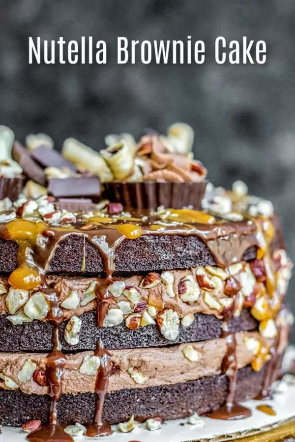 This is one of the best Nutella dessert recipes ever! Nutella Brownie Cake is layers of rich chocolate brownies, creamy Nutella frosting, toasted hazelnuts, and a smooth chocolate ganache. It is hands down the BEST cake for birthday parties and it makes a great Thanksgiving dessert, Christmas dessert, or New Year's Eve dessert! #cake #brownies #nutella #chocolate #christmas #newyears #thanksgiving #dessert #homemadeinterest