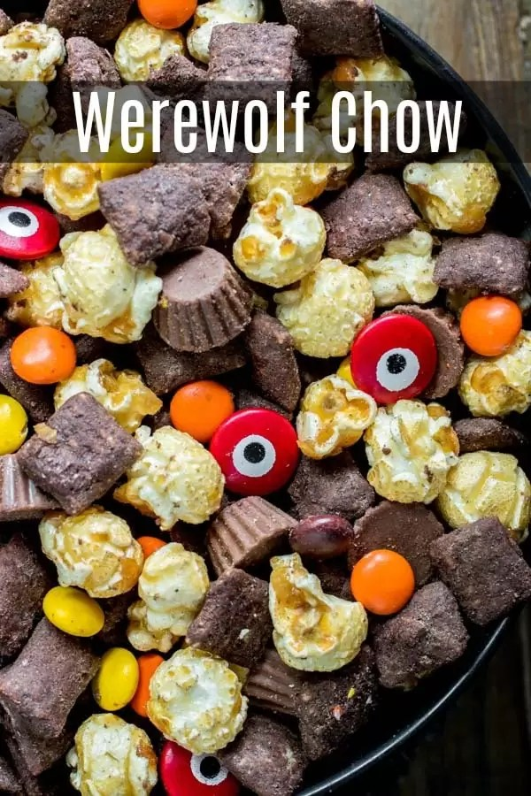 Werewolf Chow is homemade Halloween puppy chow, or muddy buddies, made with crispy, peanut butter and chocolate coated rice cereal, caramel corn, and Halloween candy! We've taken the original Chex Mix recipe and turned it into Halloween peanut butter chocolate goodness. The perfect Halloween party food ! #halloweenparty #halloween #peanutbutter #chocolate #muddybuddies #puppychow #dessert #homemadeinterest