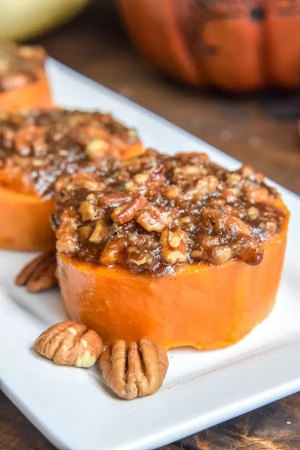 Mini Sweet Potato Casserole with brown sugar, pecans baked on top of 3 slices of sweet potato