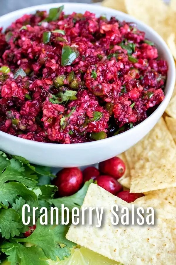 This Fresh Cranberry Salsa is an easy appetizer recipe that you can serve over cream cheese, or as a dip with tortilla chips. It is a little sweet and a little spicy made with fresh cranberries and jalapeno, and with orange juice. It is the perfect holiday appetizer for all of your Thanksgiving, Christmas and New Year's parties. AD #cranberries #salsa #appetizer #thanksgiving #christmas #newyears #dip #homemadeinterest