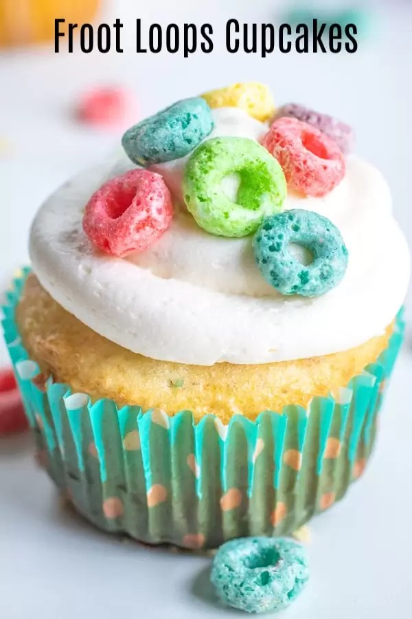 These Froot Loops Cupcakes mean you can have breakfast for dessert! Made with cereal milk, box cake mix, and crunchy Froot Loops these easy homemade cupcakes are a fun way to use Froot Loops breakfast cereal for something other than breakfast. These make a great after school snack for the kids, or just a fun dessert for the family. #ad #KelloggsCerealYourWay #breakfast #cereal #cupcakes #cupcakerecipes #dessert #homemadeinterest