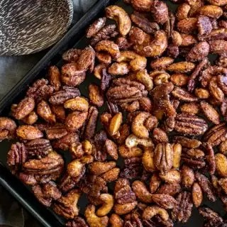 Slow Cooker Spiced Nuts on a baking sheet