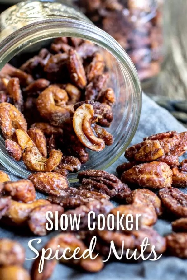 Sweet and spicy, these Slow Cooker Spiced Nuts are an easy holiday snack made with brown sugar and spices, slowly cooked in your De'Longhi Livenza Slow Cooker until the pecans, cashews, and almonds are candied. No eggs required! They make a great Christmas gift for friends and family. AD #delonghi #livewell #christmas #christmasrecipes #pecans #candiedpecans #almonds #cashews #snackmix #homemadeinterest