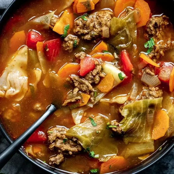 Instant Pot Cabbage Roll Soup in a bowl with spoon