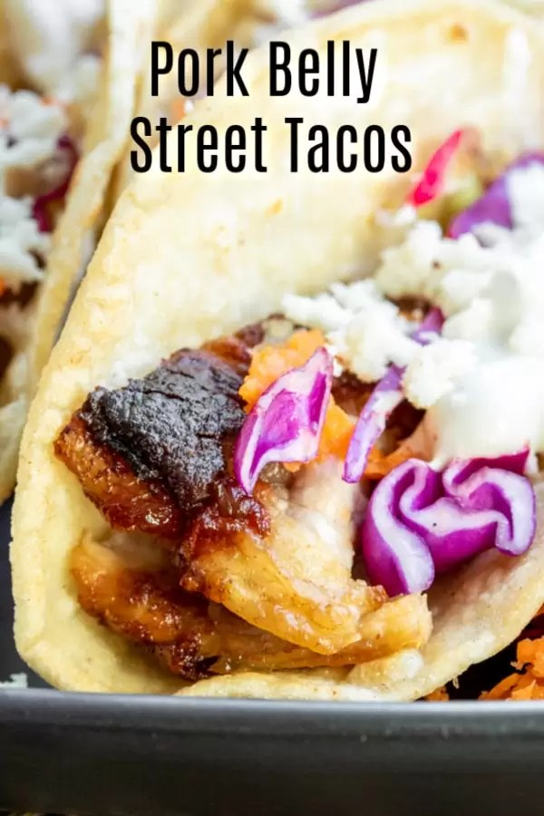 Instant Pot Pork Belly Tacos are melt-in-your-mouth, tender braised pork belly, coated in a sweet and spicy sauce, served in a mini corn tortilla. They are the ultimate game day snack! Instant Pot Pork Belly Tacos coated in your favorite BBW sauce and served street taco style make a great appetizer for parties. AD #MissionSnackShowdown #gamedayrecipe #porkbelly #instantpot #pressurecooker #instantpotpork #pressurecookerrecipes #homemadeinterest