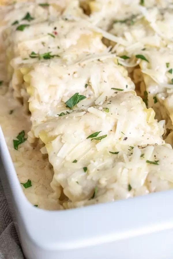 casserole dish with Chicken Alfredo Lasagna Rolls